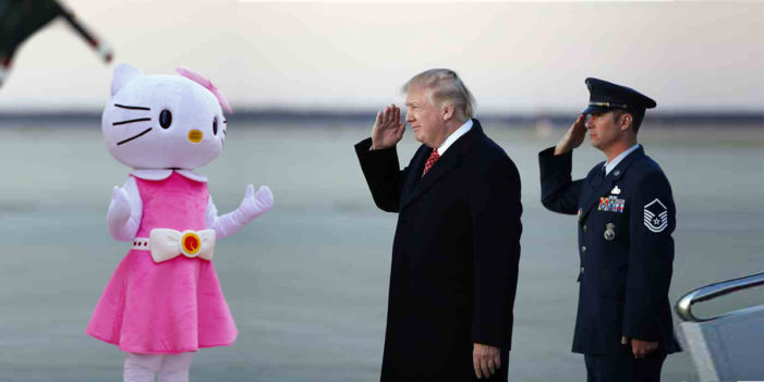 Confused President Trump Lands In Japan, Salutes Hello Kitty Mascot