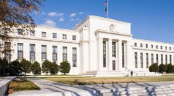 Fed Slashes Interest Rates As First Bank Tests Positive For Coronavirus